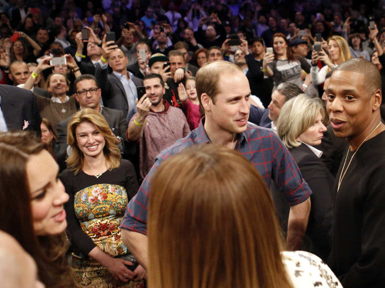 Britain's Prince William, second from right, talks with rapper and entrepreneur Jay-Z , far right, as Kate, left, the Duchess of Cambridge, chats with Jay Z's wife, entertainer Beyonce, foreground center, during an NBA basketball game between the Cleveland Cavaliers and the Brooklyn Nets at the Barclays Center in New York, Monday, Dec. 8, 2014. (AP Photo/Kathy Willens)