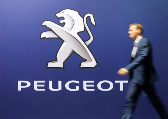 Logo of French car manufacturer Peugeot is seen at the 33th Auto Zuerich Car Show in Zurich