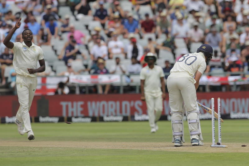 South Africa's Kagiso Rabada celebrates the wicket of England's batsman Ollie Pope during day four of the second cricket test between South Africa and England at the Newlands Cricket Stadium in Cape Town, South Africa, Monday Jan. 6, 2020. (AP Photo/Halden Krog)