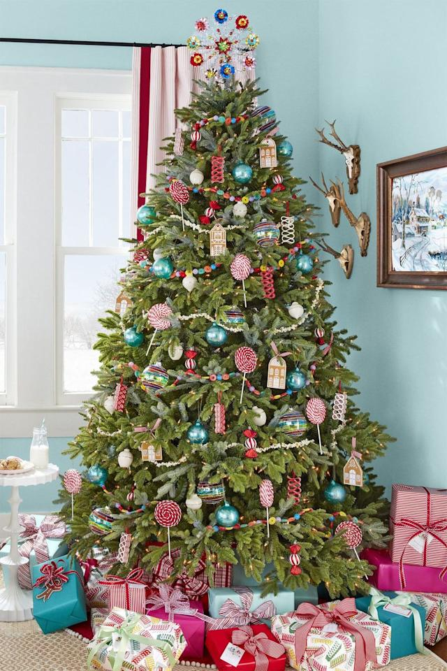 """<p>Forget the candy dishes: Make your house even sweeter by decorating your Christmas tree with sugar-themed garland and ornaments (real candy ribbon included!).</p><p><em><a href=""""https://www.countryliving.com/home-design/decorating-ideas/tips/g1251/trim-christmas-trees-1208/"""" target=""""_blank"""">Get the tutorial at Country Living »</a></em></p>"""