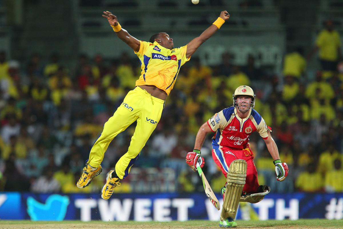 Dwayne Bravo leaps but misses the ball during match 16 of the Pepsi Indian Premier League between The Chennai Superkings and the Royal Challengers Bangalore held at the MA Chidambaram Stadiumin Chennai on the 13th April 2013. (BCCI)