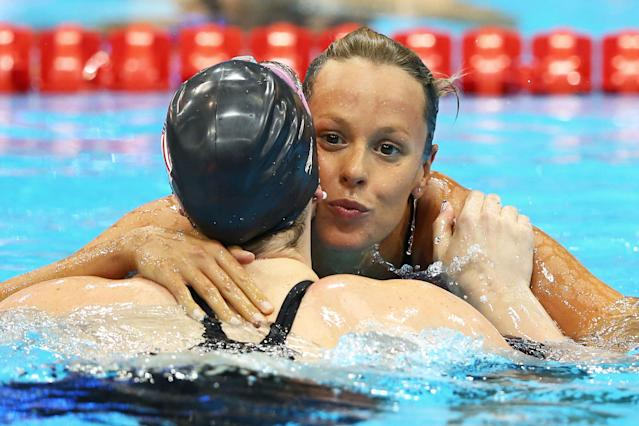 LONDON, ENGLAND - JULY 30: (L-R) Missy Franklin of the United States and Federica Pellegrini of Italy react after they competed in the second semifinal heat of Women's 200m Freestyle on Day 3 of the London 2012 Olympic Games at the Aquatics Centre on July 30, 2012 in London, England. (Photo by Al Bello/Getty Images)