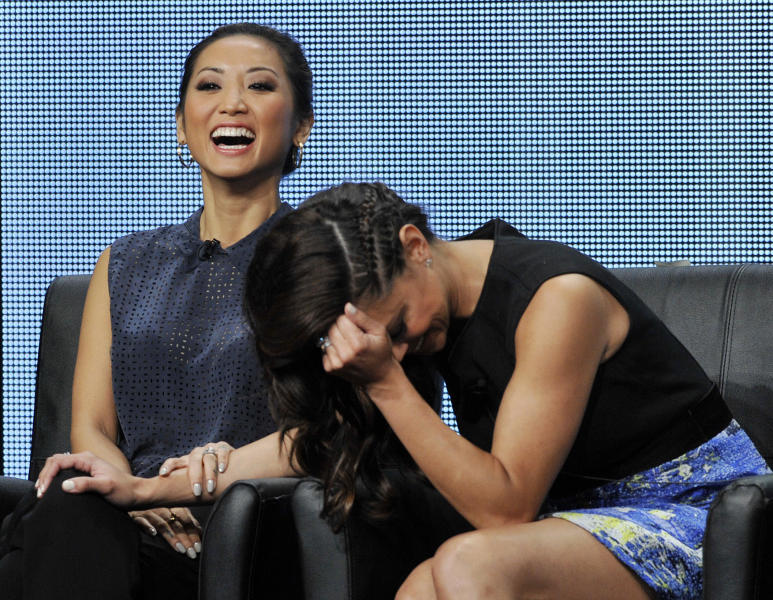 "Brenda Song, left, and Vanessa Lachey, cast members in the FOX series ""dads,"" laugh during a panel discussion on the show at the FOX 2013 Summer TCA press tour at the Beverly Hilton Hotel on Thursday, Aug. 1, 2013 in Beverly Hills, Calif. (Photo by Chris Pizzello/Invision/AP)"