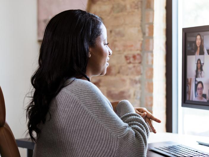 A woman uses video conferencing to chat with colleagues (Getty Images)