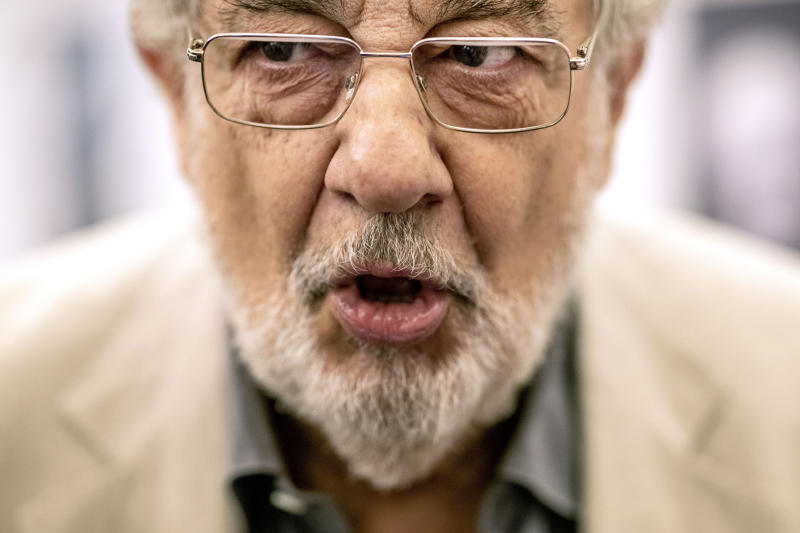 """FILE - In this July 12, 2019, file photo, Placido Domingo speaks during a news conference about his upcoming show """"Giovanna d'Arco"""" in Madrid, Spain. Domingo is scheduled to appear onstage at the Salzburg Festival on Aug. 25, 2019, to perform for the first time since multiple women have accused the opera legend of sexual harassment in allegations brought to light by The Associated Press. (AP Photo/Bernat Armangue, File)"""