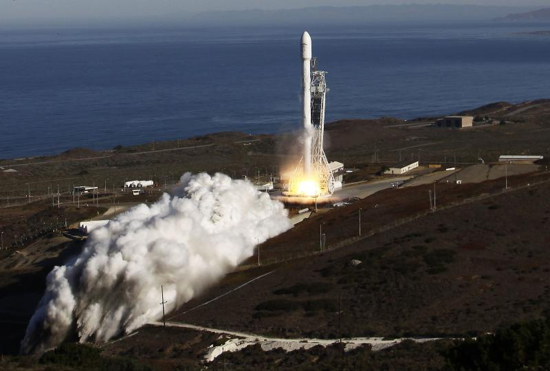 A Falcon 9 rocket carrying a small science satellite for Canada is seen as it is launched from a newly refurbished launch pad in Vandenberg Air Force Station