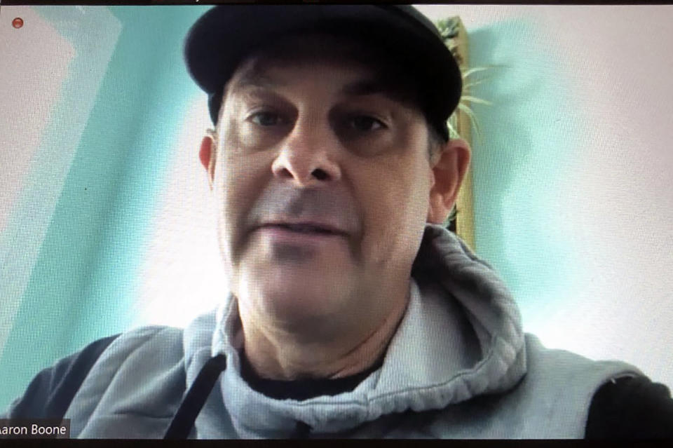 This screengrab from a Zoom call, Friday, March 5, 2021, shows New York Yankees manager Aaron Boone. Boone said he's feeling better after getting a pacemaker and said he hopes to return to the team Saturday or Sunday. (AP Photo/Ron Blum)