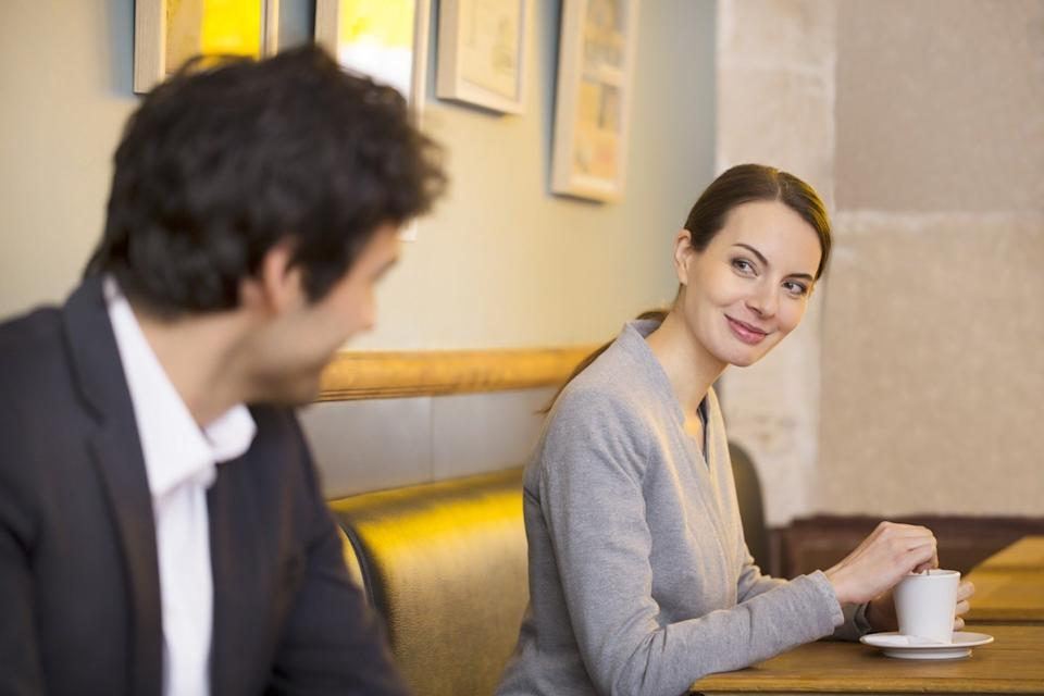 Woman flirting with man using facial expression