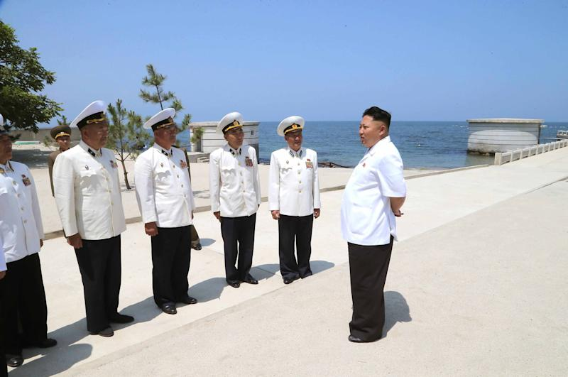 North Korean leader Kim Jong-Un inspecting KPA Navy officers at an undisclosed location in a handout picture from KCNA on July 2, 2014 (AFP Photo/via KNS)
