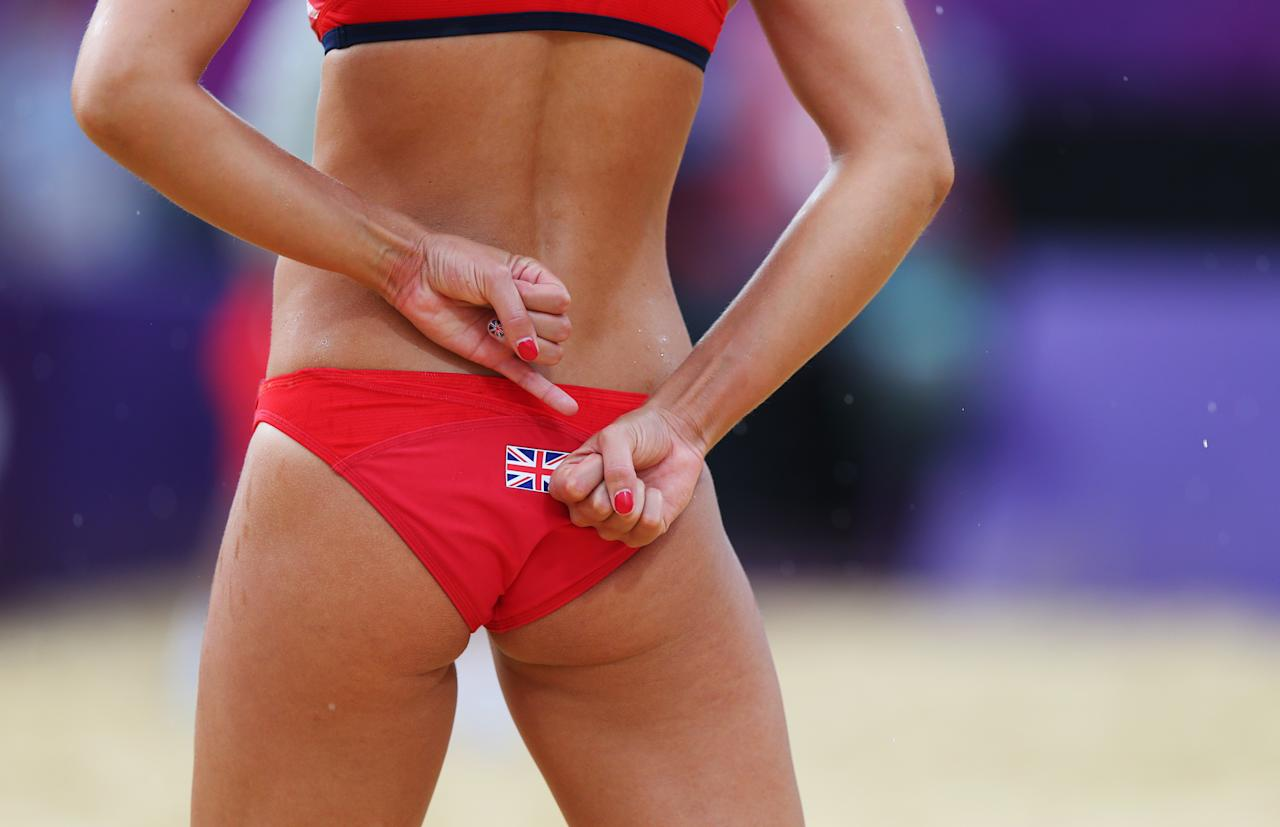 LONDON, ENGLAND - JULY 29:  Zara Dampney of Great Britain signals during the Women's Beach Volleyball Preliminary match between Great Britain and Canada on Day 2 of the London 2012 Olympic Games at Horse Guards Parade on July 29, 2012 in London, England.  (Photo by Ryan Pierse/Getty Images)