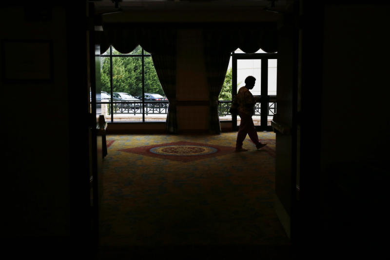 In this June 24 2013, photo, a job seeker exits after attending a career fair, in King of Prussia, Pa. The Labor Department reports on the number of Americans who applied for unemployment benefits last week on July 11, 2013. (AP Photo/Matt Slocum)
