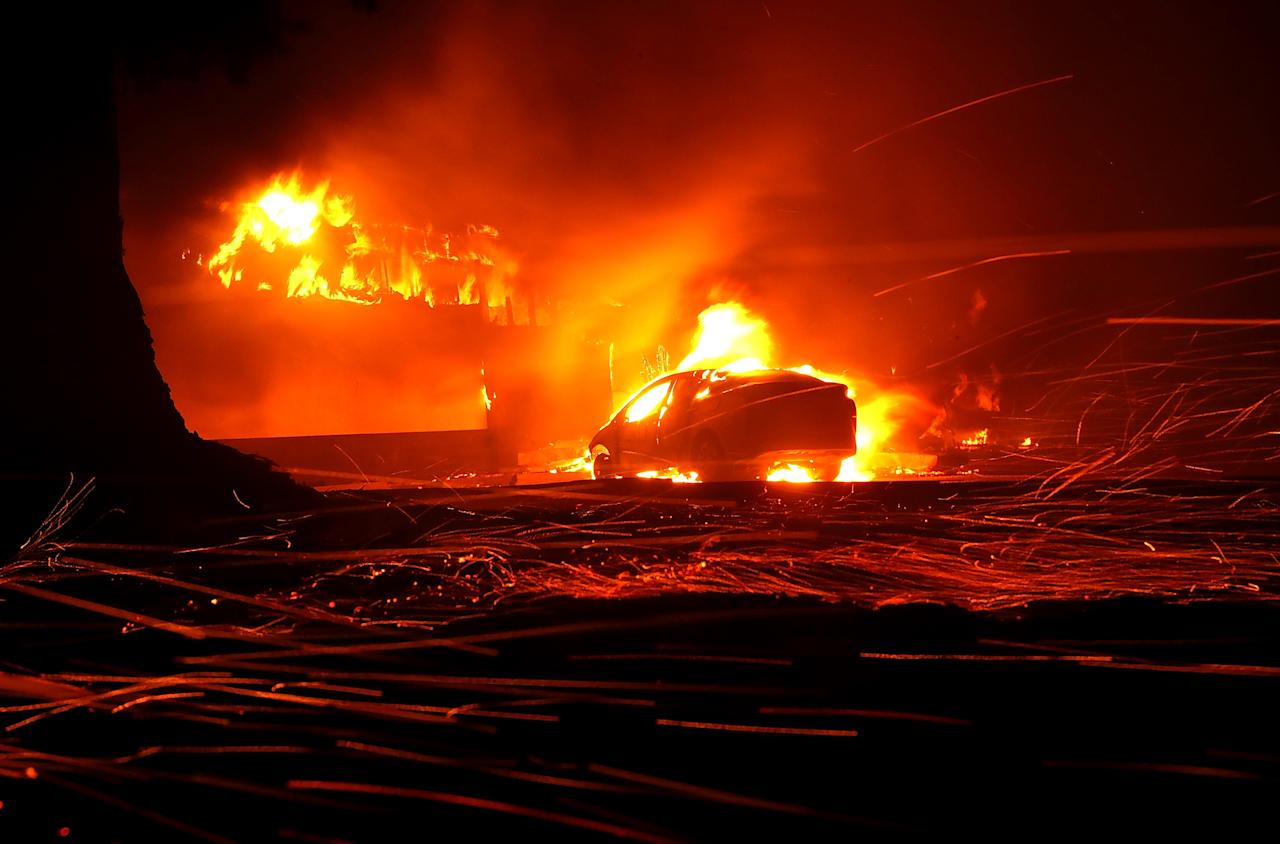<p>Wildfires ripping through North and South California have lead to dozens of death and over 200 missing. Left behind are remnants of homes, cars, and creatures left to race the speed of the flames.<br />(Photos by Justin Sullivan/Getty Images) </p>