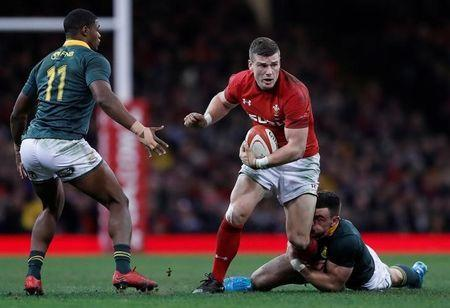 Wales' Scott Williams in action with South Africas' Jesse Kriel and Warrick Gelant. REUTERS/Rebecca Naden