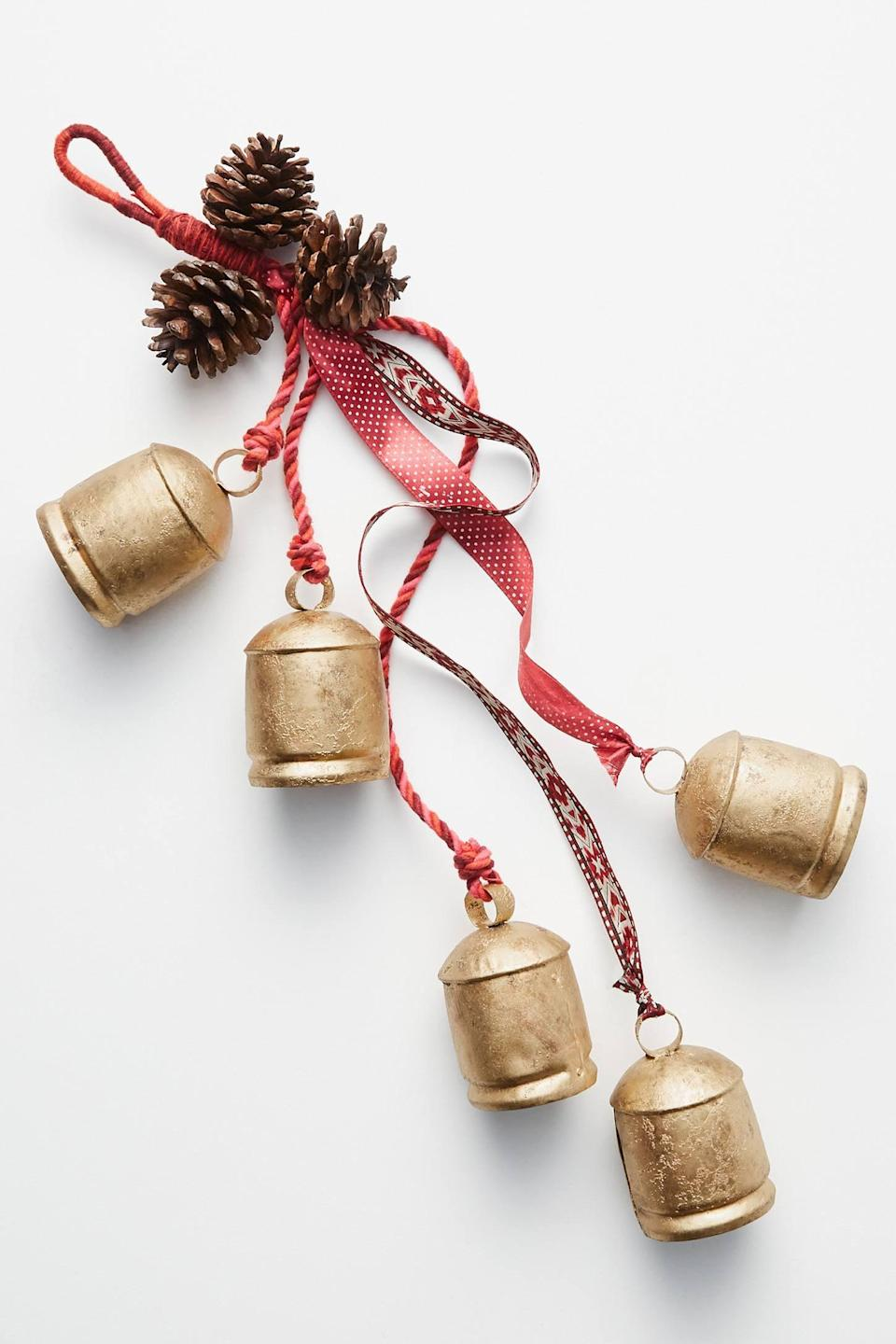 """<p>Add holiday cheer into your home with the <a href=""""https://www.popsugar.com/buy/Pinecones-Bells-Door-Hanger-490582?p_name=Pinecones%20and%20Bells%20Door%20Hanger&retailer=anthropologie.com&pid=490582&price=38&evar1=casa%3Aus&evar9=46615300&evar98=https%3A%2F%2Fwww.popsugar.com%2Fhome%2Fphoto-gallery%2F46615300%2Fimage%2F46615453%2FPinecones-Bells-Door-Hanger&list1=shopping%2Canthropologie%2Choliday%2Cchristmas%2Cchristmas%20decorations%2Choliday%20decor%2Chome%20shopping&prop13=mobile&pdata=1"""" rel=""""nofollow noopener"""" class=""""link rapid-noclick-resp"""" target=""""_blank"""" data-ylk=""""slk:Pinecones and Bells Door Hanger"""">Pinecones and Bells Door Hanger</a> ($38).</p>"""