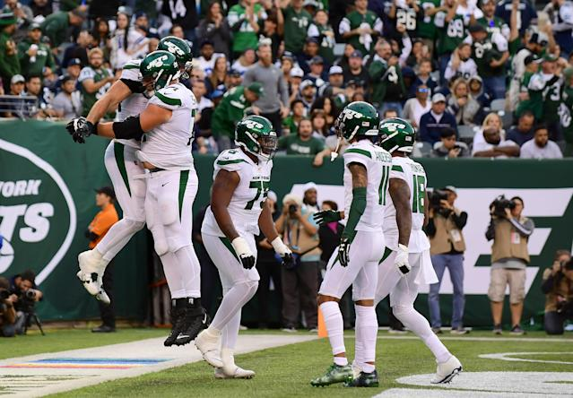 The New York Jets are celebrating their first win of the season. (Getty Images)