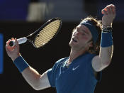 Russia's Andrey Rublev reacts after losing a point to compatriot Daniil Medvedev during their quarterfinal match at the Australian Open tennis championship in Melbourne, Australia, Wednesday, Feb. 17, 2021.(AP Photo/Andy Brownbill)