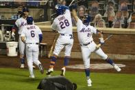 New York Mets' J.D. Davis (28) celebrates with teammate Pete Alonso (20) after hitting a three-run home run during the seventh inning of a baseball game against the Miami Marlins Saturday, Aug. 8, 2020, in New York. (AP Photo/Frank Franklin II)
