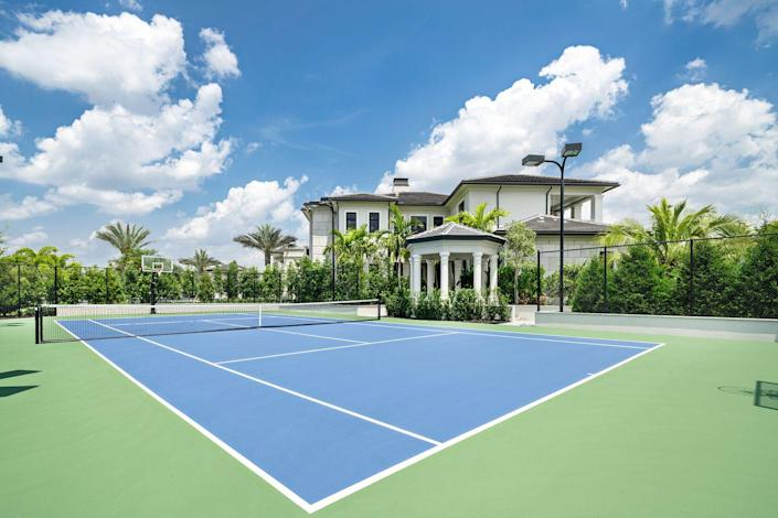 A championship-sized tennis court is perfect for outdoor activities.
