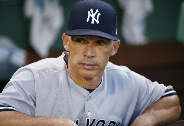 FILE - In this July 16, 2017, New York Yankees manager Joe Girardi stands in the dugout before the second game of the baseball team's doubleheader against the Boston Red Sox in Boston. Former Chicago Cubs catchers David Ross and Girardi will speak with the team next week about its managerial opening. The team also plans to interview first base coach Will Venable next week. Bench coach Mark Loretta interviewed for the job Thursday. The Cubs are searching for a successor to Joe Maddon, whose contract expired after the Cubs missed the playoffs this year for the first time since 2014. (AP Photo/Michael Dwyer, File)