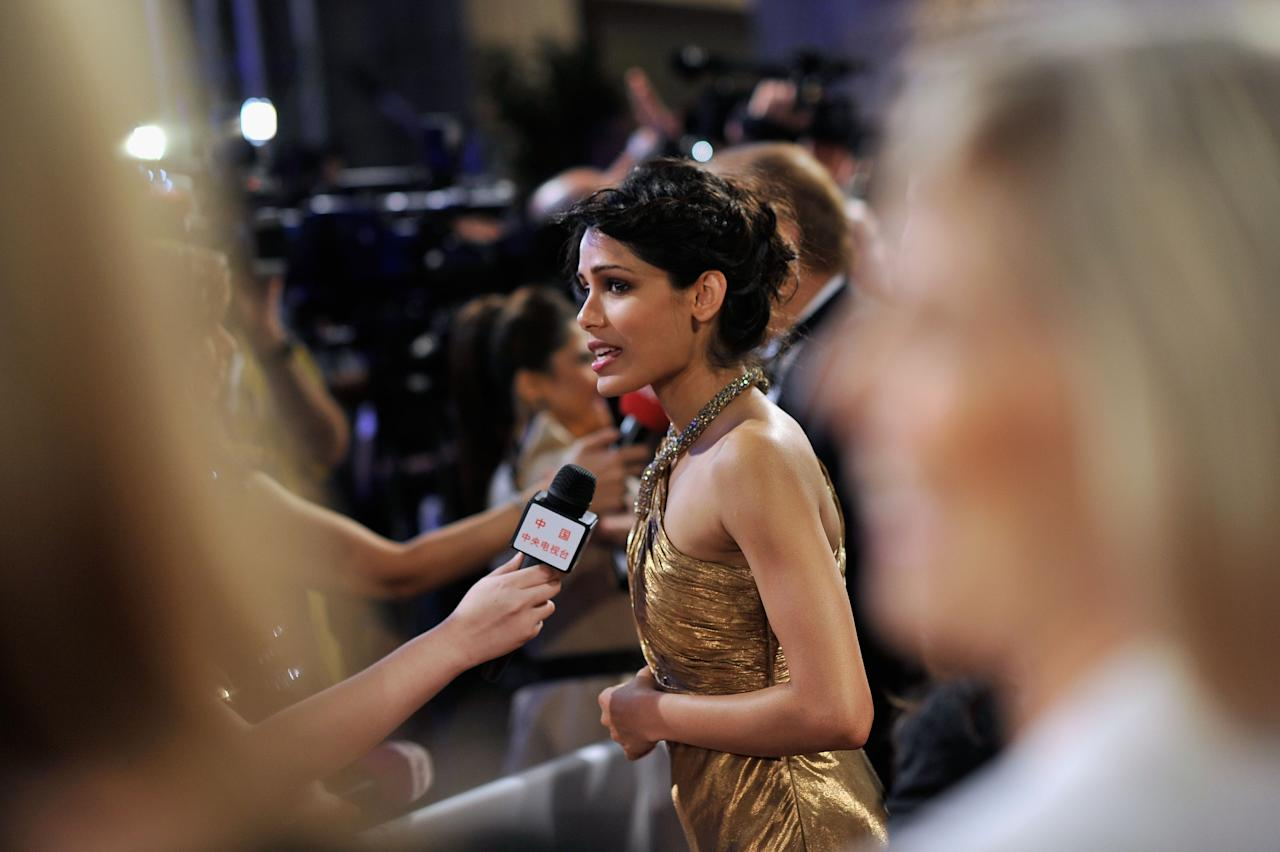 "DUBAI, UNITED ARAB EMIRATES - DECEMBER 09:  Actress Freida Pinto attends the ""Life of PI"" Opening Gala during day one of the 9th Annual Dubai International Film Festival held at the Madinat Jumeriah Complex on December 9, 2012 in Dubai, United Arab Emirates.  (Photo by Gareth Cattermole/Getty Images for DIFF)"