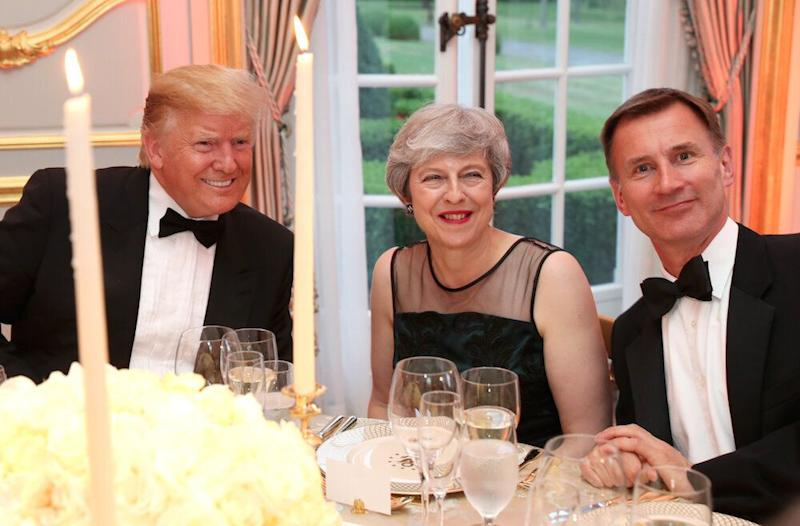 Donald Trump, Theresa May and Jeremy Hunt at dinner at the US Ambassador's residence in London last week (Picture; PA)