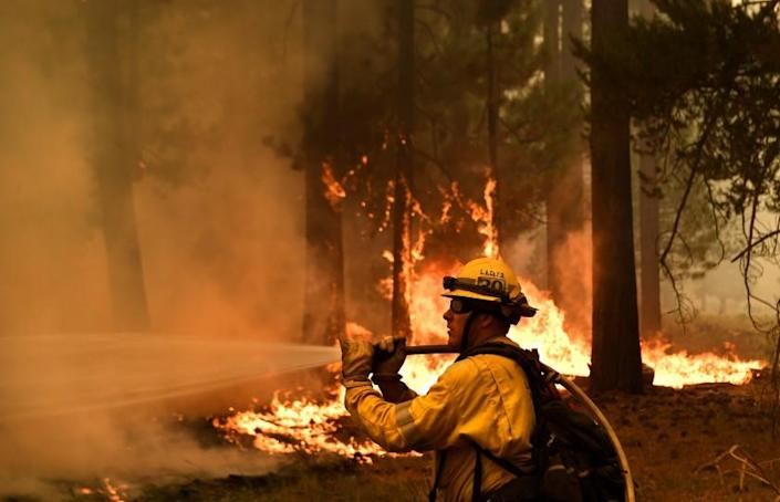 Lake Tahoe, CA. August 31, 2021: L.A. County firefighter Kevin Reid battles the Caldor Fire off Highway 89 west of Lake Tahoe Tuesday.(Wally Skalij/Los Angeles Times)