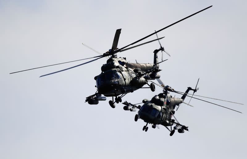 FILE PHOTO: Belarusian military helicopters fly during the Zapad 2017 war games near the village of Volka