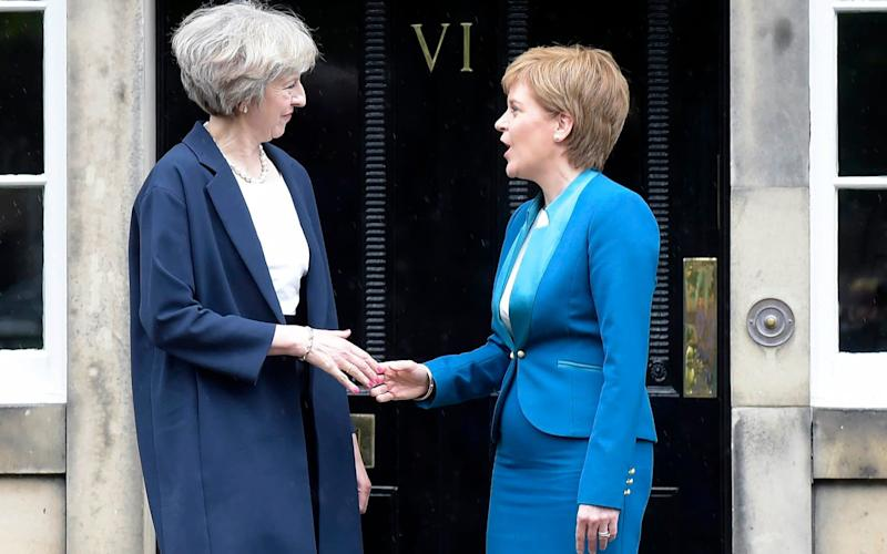 Theresa May and Nicola Sturgeon - Credit: LESLEY MARTIN/AFP/