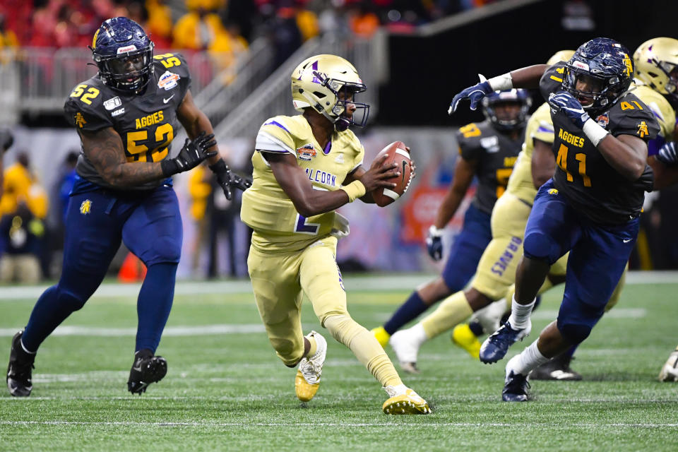 Alcorn State quarterback Felix Harper tries to evade the defense of North Carolina A&T linebacker Julian Monell (53) and defensive lineman Leon Smalls (41) during the second half of the Celebration Bowl NCAA college football game, Saturday, Dec. 21, 2019, in Atlanta. North Carolina A&T won 64-44. (John Amis/Atlanta Journal-Constitution via AP)