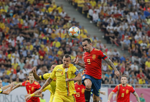 Spain's Paco Alcacer jumps for a header with Romania's Vlad Chiriches during the Euro 2020 group F qualifying soccer match between Romania and Spain, at the National Arena stadium in Bucharest, Romania, Thursday, Sept. 5, 2019. (AP Photo/Vadim Ghirda)