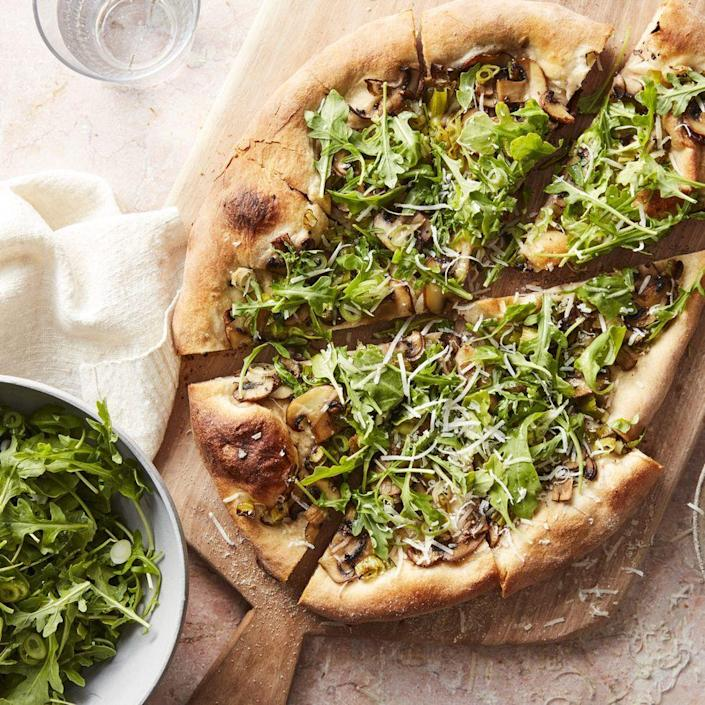 "<p>Who says pizza can't be light? This veggie pie is delicious and only takes 20 minutes. So, if you need a meal that everyone will love and you can whip up quickly after work, look no further. </p><p><em><a href=""https://www.womansday.com/food-recipes/a32676434/mushroom-and-arugula-salad-pizza-recipe/"" rel=""nofollow noopener"" target=""_blank"" data-ylk=""slk:Get the Mushroom and Arugula Salad Pizza recipe."" class=""link rapid-noclick-resp"">Get the Mushroom and Arugula Salad Pizza recipe.</a></em></p>"