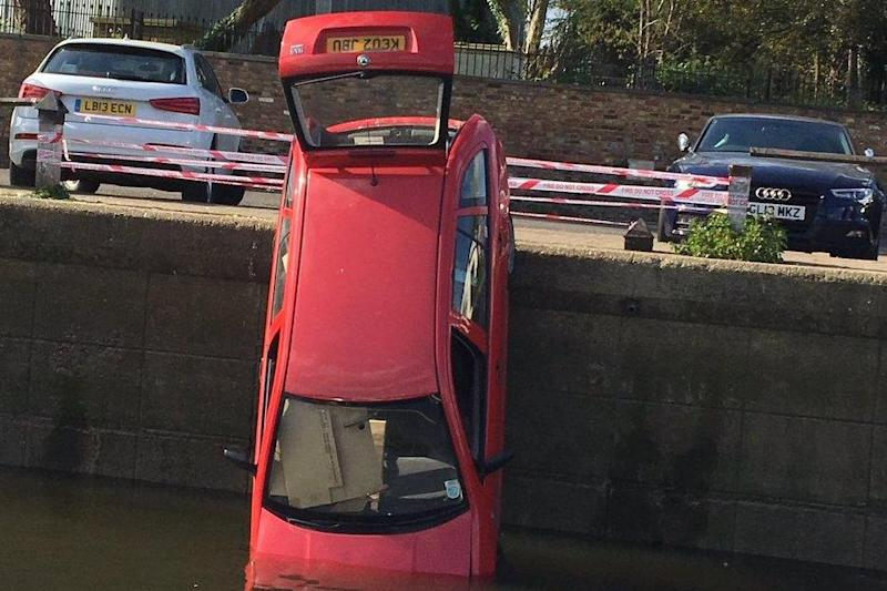 River crash: The car was crashed into the River Thames on Saturday afternoon: Hounslow MPS