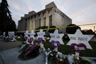 FILE - In this Oct. 29, 2018 file photo, a makeshift memorial stands outside the Tree of Life Synagogue in the aftermath of a deadly shooting at the in Pittsburgh. Organizers have strived to offer emotional support during the second anniversary commemorations. One-on-one counseling will be offered virtually, and there's a tent set up near the synagogue where people can access in-person support from humans and comfort dogs. (AP Photo/Matt Rourke, File)