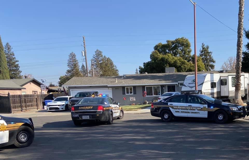 Police outside a home in San Joaquin County in the US state of California where Adam Llanos died by suicide.