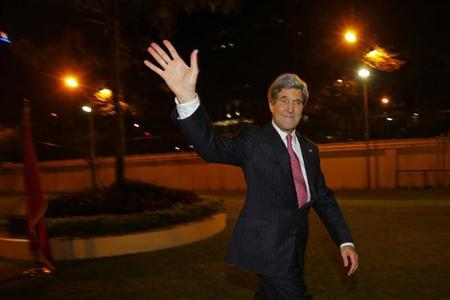 U.S. Secretary of State John Kerry waves to the crowd after greeting staff at the U.S. Consulate in Ho Chi Minh City