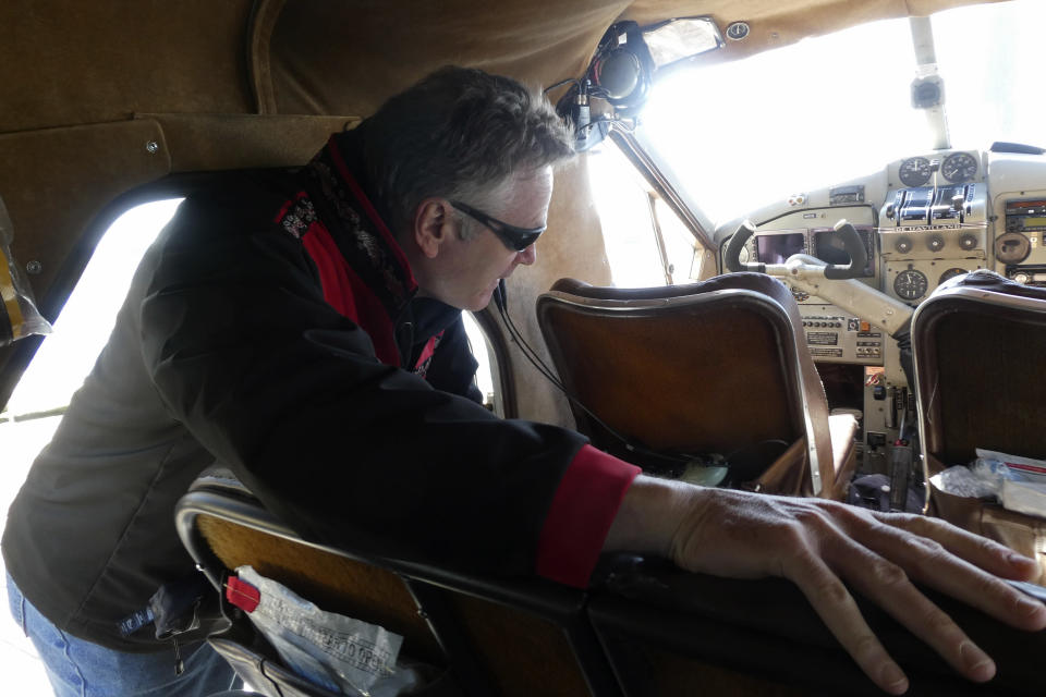 Alaska Gov. Mike Dunleavy climbs into a float plane in Ketchikan, Alaska, on Thursday, April 22, 2021, as he prepares to travel to the community of Hyder near the U.S.-Canada border. Dunleavy visited several southeast Alaska communities as part of a one-day trip. (AP Photo/Becky Bohrer)