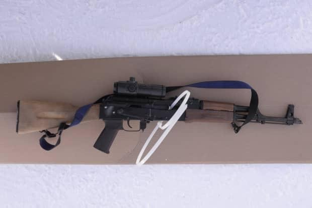 An AK-47 was seized in the investigation.