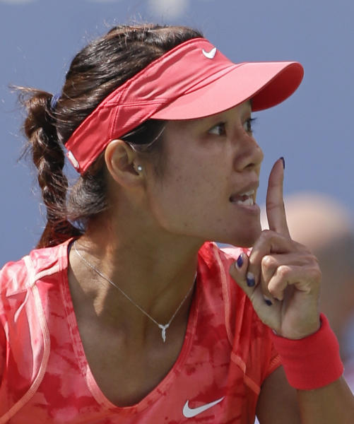 Li Na, of China, motions for silence to the crowd between points during her match against Ekaterina Makarova, of Russia, during the quarterfinals of the 2013 U.S. Open tennis tournament, Tuesday, Sept. 3, 2013, in New York. (AP Photo/Julio Cortez)