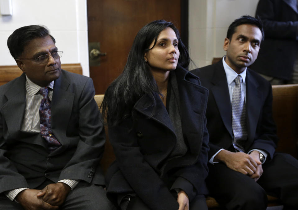 <p> Annie Dookhan, center, sits between two unidentified men in Suffolk Superior Court moments before her arraignment in Boston, Thursday, Dec. 20, 2012. Dookhan, the former chemist at the center of a U.S. drug testing scandal, pleaded not guilty to charges including perjury and tampering with evidence. (AP Photo/Steven Senne, Pool) </p>