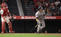 Seattle Mariners' Tom Murphy watches his three-run home run next to Los Angeles Angels catcher Jonathan Lucroy during the sixth inning of a baseball game Friday, June 7, 2019, in Anaheim, Calif. (AP Photo/Mark J. Terrill)