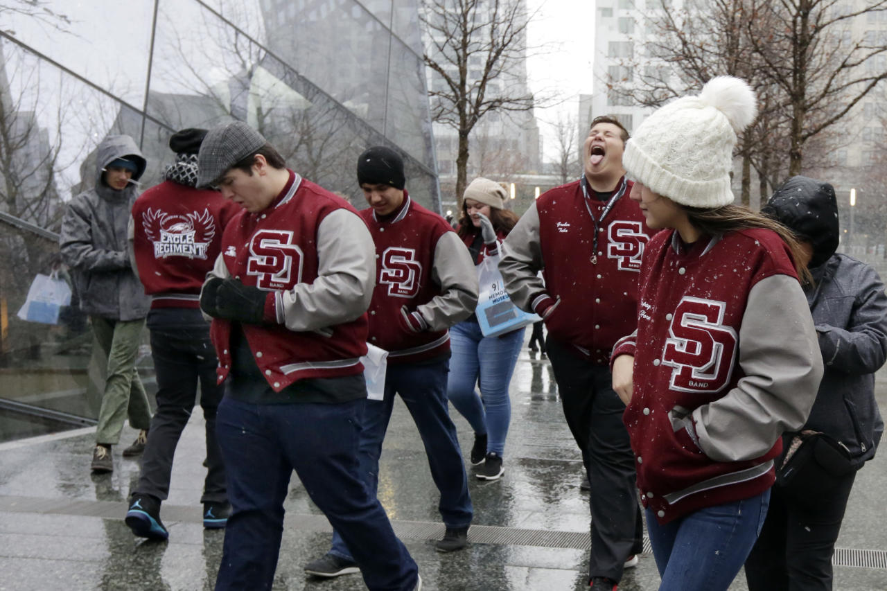 Students from Marjory Stoneman Douglas High School Wind Symphony, in Parkland, Fla., encounter snow after their visit to the 9/11 Museum & Memorial, in New York, Wednesday, March 7, 2018. The group, who had planned the trip before the Feb. 14 rampage at their school, toured the museum that commemorates the deadliest act of terrorism on U.S. soil. (AP Photo/Richard Drew)