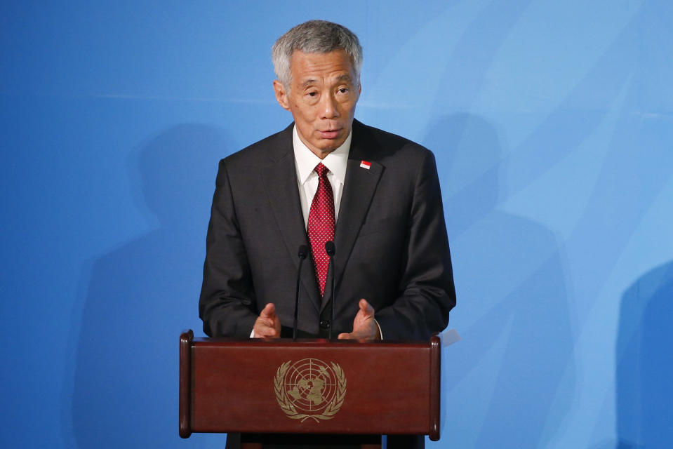 Singapore's Prime Minister Lee Hsien Loong addresses the Climate Action Summit in the United Nations General Assembly, at U.N. headquarters, Monday, Sept. 23, 2019. (AP Photo/Jason DeCrow)