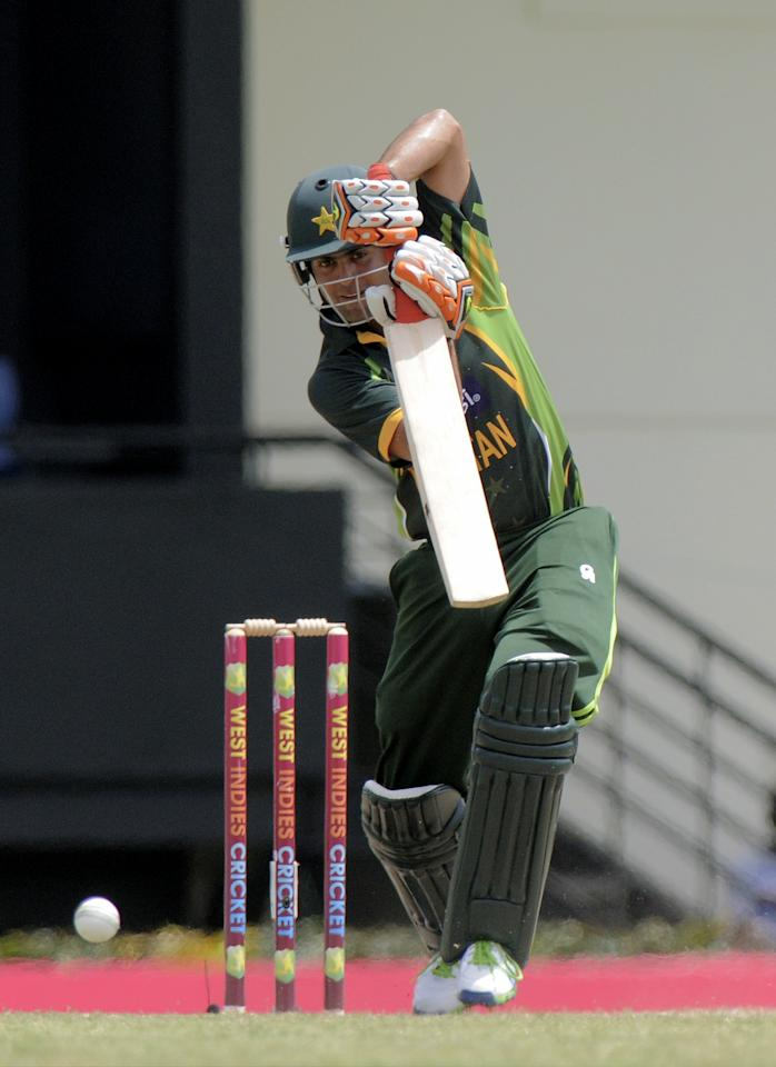 Pakistan opening batsman Ahmed Shehzad defends his 38 runs during the 5th and final ODI West Indies v Pakistan  on July 24, 2013 at Beausejour Cricket Ground, in Gros Islat, St. Lucia. The score was WI 242/7, Pak 75/2 (20 ov).AFP PHOTO/RANDY BROOKS        (Photo credit should read RANDY BROOKS/AFP/Getty Images)