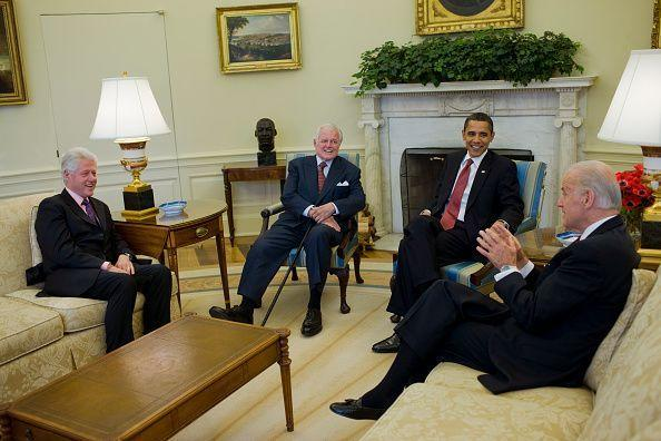 <p>President Obama discusses national service with Senator Ted Kennedy, former President Bill Clinton, and Biden in the Oval Office in April 2009. </p>