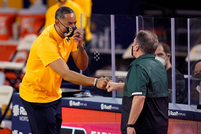 Michigan coach Juwan Howard, left, shakes hands with Michigan State coach Tom Izzo after the Wolverines' 69-50 win at Crisler Center in Ann Arbor, March 4, 2021.