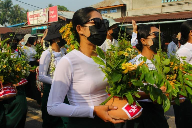Protestors have been painting pro-democracy messages on flower pots traditionally displayed to welcome the Myanmar new year