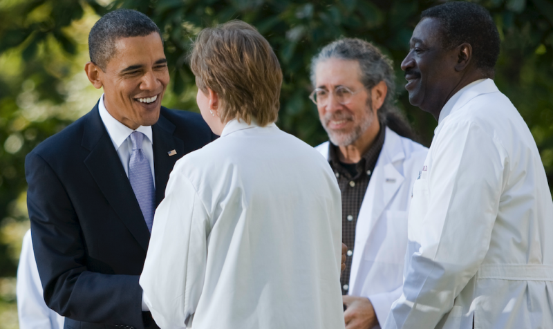 President Barack Obama greets doctors on stage after delivering remarks on the need for health insurance reform this year, in the Rose Garden of the White House in Washington in October 2009. (Photo: Brooks Kraft LLC/Corbis via Getty Images)