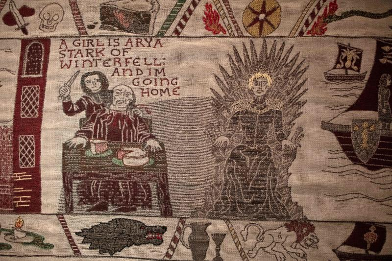 Embroidered scenes on the tapestry depicting the hit television series Game of Thrones are on show at the Ulster Museum in Belfast on July 5, 2019. - Like the Bayeux Tapestry, the Game of Thrones Tapestry is woven of fine linen and hand-embroidered, with decorative borders and a central pictorial narrative. It will reach 90 metres by the end of the final season of the show. (Photo by Paul Faith / AFP) (Photo credit should read PAUL FAITH/AFP/Getty Images)
