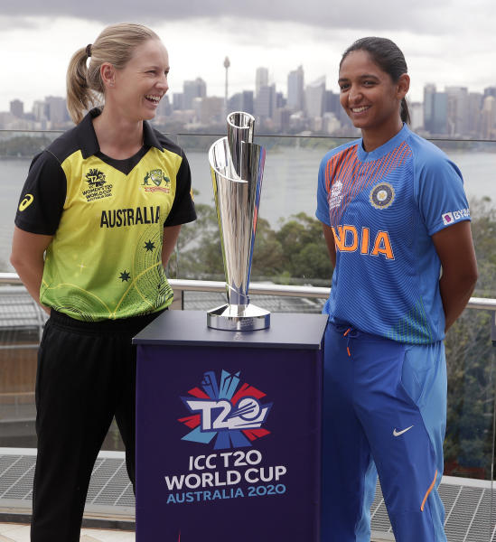 Cricket captains Meg Lanning of Australia, left, and Harmanpreet Kaur of India pose for a photo with the trophy ahead of the Women's T20 World Cup in Sydney, Monday, Feb. 17, 2020. The tournament begins with a game between Australia and India, Friday, Feb. 21. (AP Photo/Rick Rycroft)