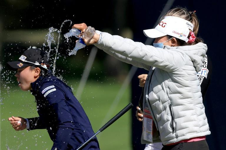 Yuka Saso (L) was doused with water after winning the 76th US Women's Open